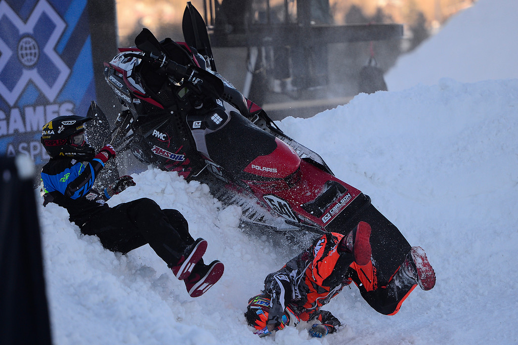 . Trevor Leighton and Ryan Springer falls off their snowmobile after crashing into during Heat 1B of SnoCross at Winter X Games 2016 at Buttermilk Mountain on January 28, 2016 in Aspen, Colorado. Kevin Rolland took the gold in the event with a score of 93.33 with the win coming after his final run. (Photo by Brent Lewis/The Denver Post)