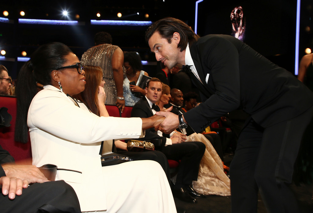 . Oprah Winfrey, left, and Milo Ventimiglia appear in the audience at the 69th Primetime Emmy Awards on Sunday, Sept. 17, 2017, at the Microsoft Theater in Los Angeles. (Photo by John Salangsang/Invision for the Television Academy/AP Images)