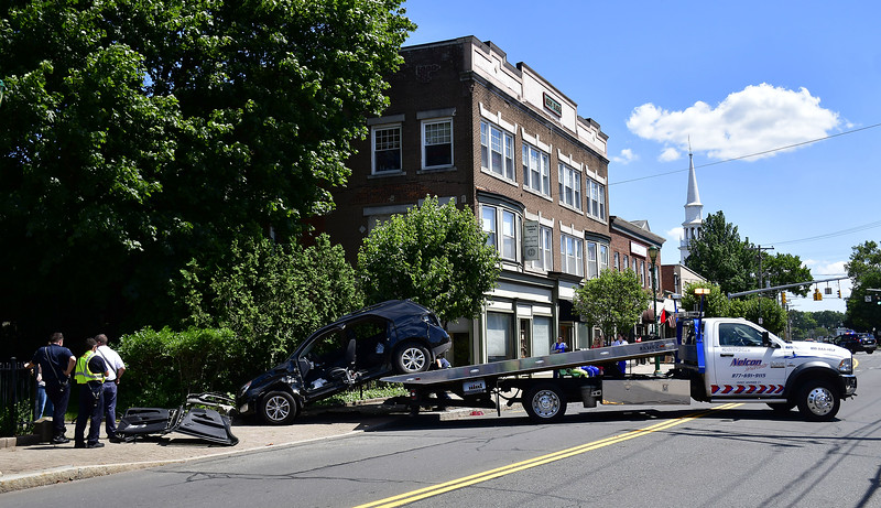 6/27/2019 Mike Orazzi   Staff The scene of a single vehicle crash in downtown Southington Thursday afternoon in front the Barnes Museum.