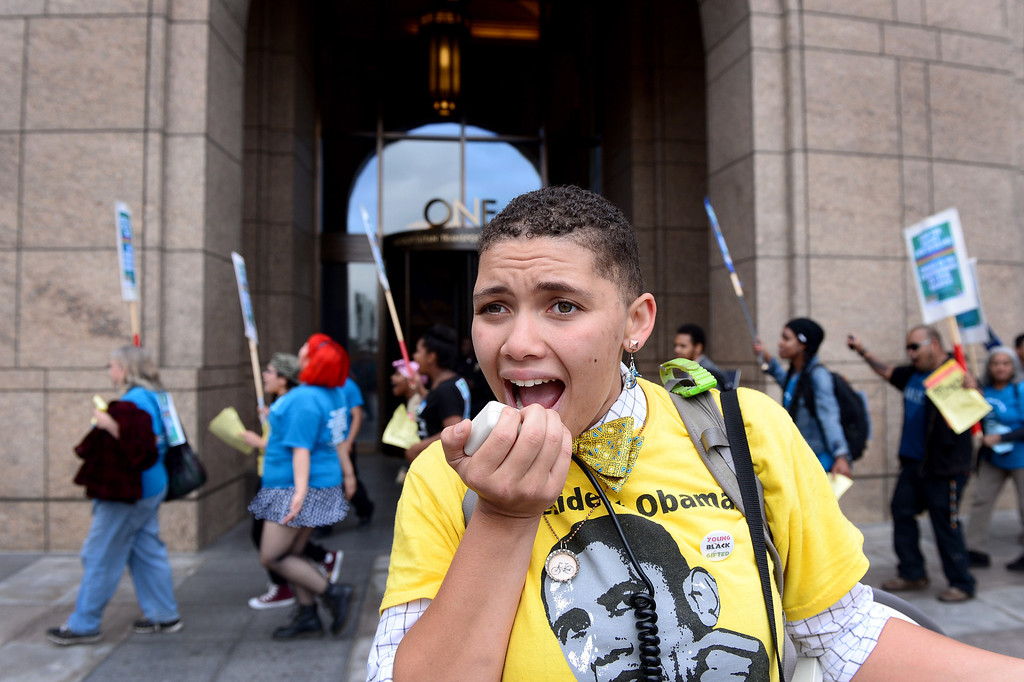 . Tekoah Flory, 21, of Los Angeles and an organizer for the Bus Riders Union, leads a protest before the MTA board meeting voted for a major fare increase Thursday, May 22, 2014. The increase will effect 500,000 riders of trains, subways and buses in Los Angeles County. Students rates will not increase. (Photo by Sarah Reingewirtz/Pasadena Star-News)