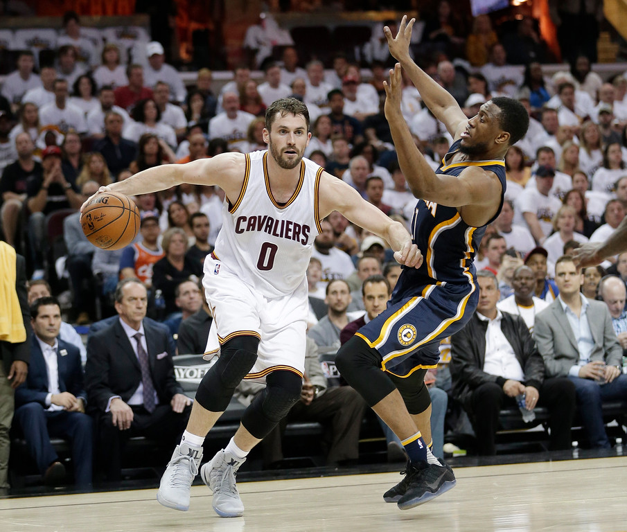 . Cleveland Cavaliers\' Kevin Love (0) is fouled by Indiana Pacers\' Thaddeus Young (21) in the first half in Game 1 of a first-round NBA basketball playoff series, Saturday, April 15, 2017, in Cleveland. (AP Photo/Tony Dejak)