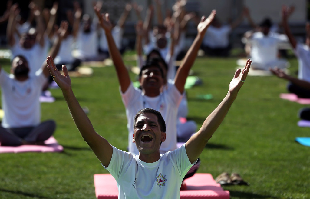. Afghans and foreigners perform yoga to mark International Yoga Day at the Indian Embassy, in Kabul, Afghanistan, Wednesday, Jun 21, 2017. Thousands of yoga enthusiasts took part in mass yoga programs to mark International Yoga Day throughout the world. (AP Photo/Massoud Hossaini)