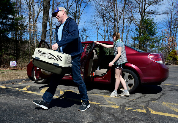 3/27/2020 MIke Orazzi | Staff John Andros and his daughter Audrey arrive at Chippens Hill Veterinary Hospital for veterinary services on Friday for their cat Collette.. Customers are being asked to wait in their vehicles.
