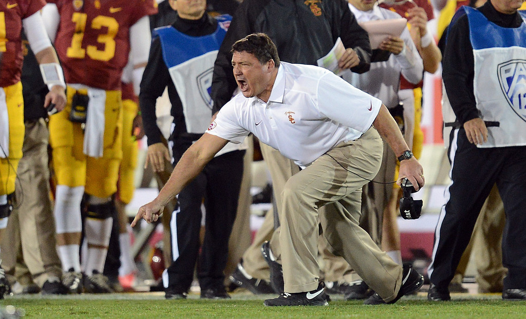 . USC coach Ed Orgeron reacts after picking up a first down on fourth down in the fourth quarter during their game at the Los Angeles Memorial Coliseum Saturday, November 16, 2013. USC beat Stanford 20-17. (Photos by Hans Gutknecht/Los Angeles Daily News)