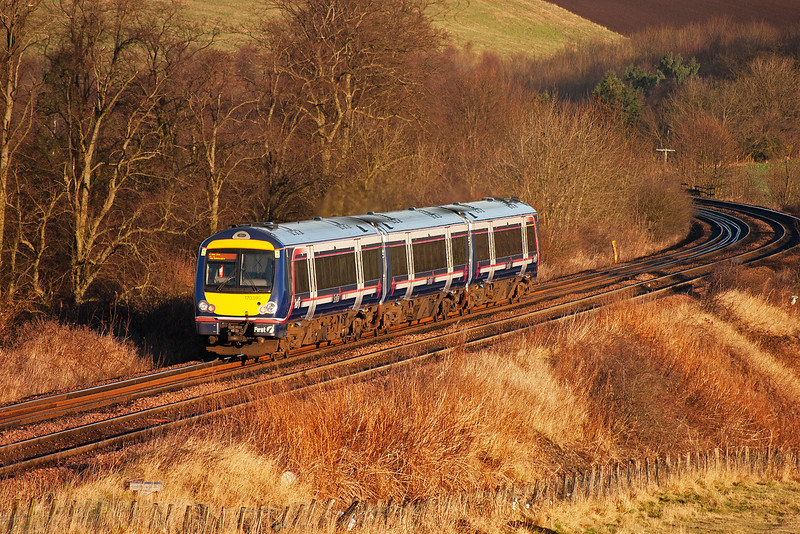 In wonderful light, just two days before Christmas, 170395 powers away from Markinch up the 1 in 102 1/2 gradient with 1L37 0940 Edinburgh to Perth where it will connect with a Glasgow to Inverness service.