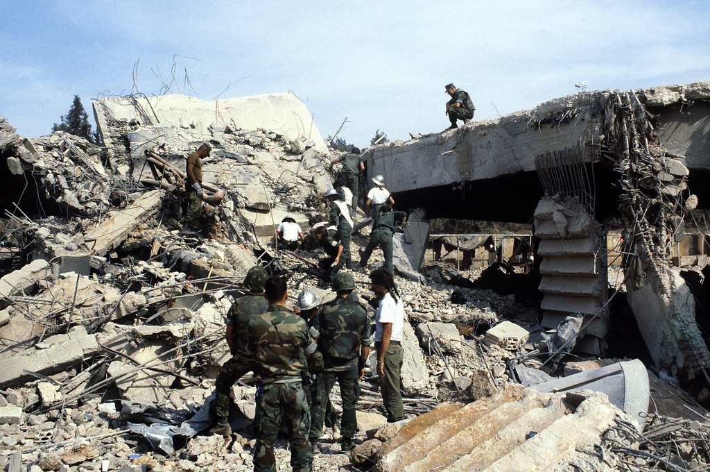 . US marines continue to search for victims, on October 31, 1983, after a terrorist attack against the headquarters of the U.S. troops of the multinational force that killed 241 American soldiers on October 23, 1983 in Beirut. (Photo credit should read PHILIPPE BOUCHON/AFP/Getty Images)
