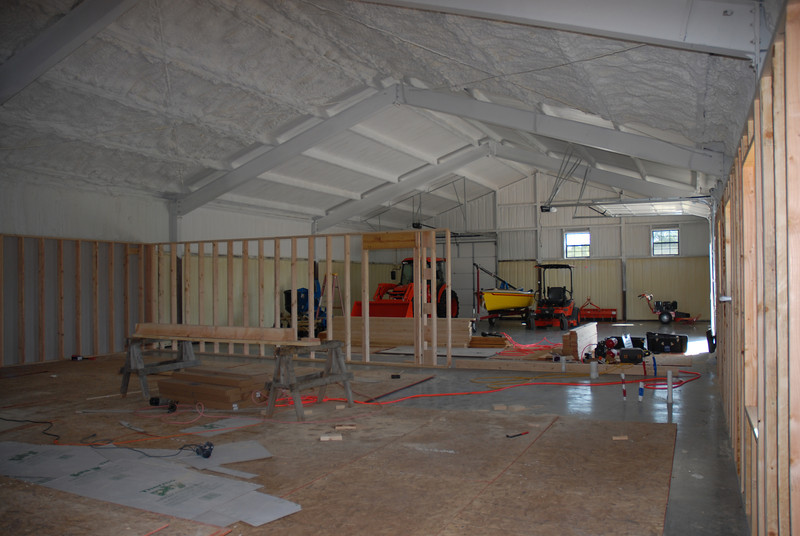 Dividing barn into living and equipment areas