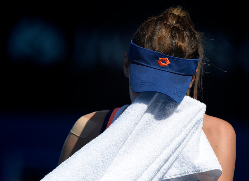 . Agnieszka Radwanska of Poland wipes the sweat from her face as she plays Dominika Cibulkova of Slovakia during their semifinal at the Australian Open tennis championship in Melbourne, Australia, Thursday, Jan. 23, 2014.(AP Photo/Andrew Brownbill)