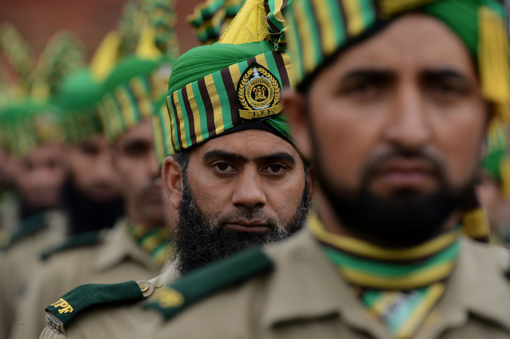 ". Jammu and Kashmir Forest Protection Force (FPF) personnel stand in formation during celebrations marking India\'s Independence Day at The Bakshi Stadium in Srinagar on August 15, 2013. Premier Manmohan Singh warned Pakistan August 15 against using its soil for ""anti-India activity\"", following a fresh escalation of tensions between the nuclear-armed neighbours over a deadly attack on Indian soldiers. TAUSEEF MUSTAFA/AFP/Getty Images"