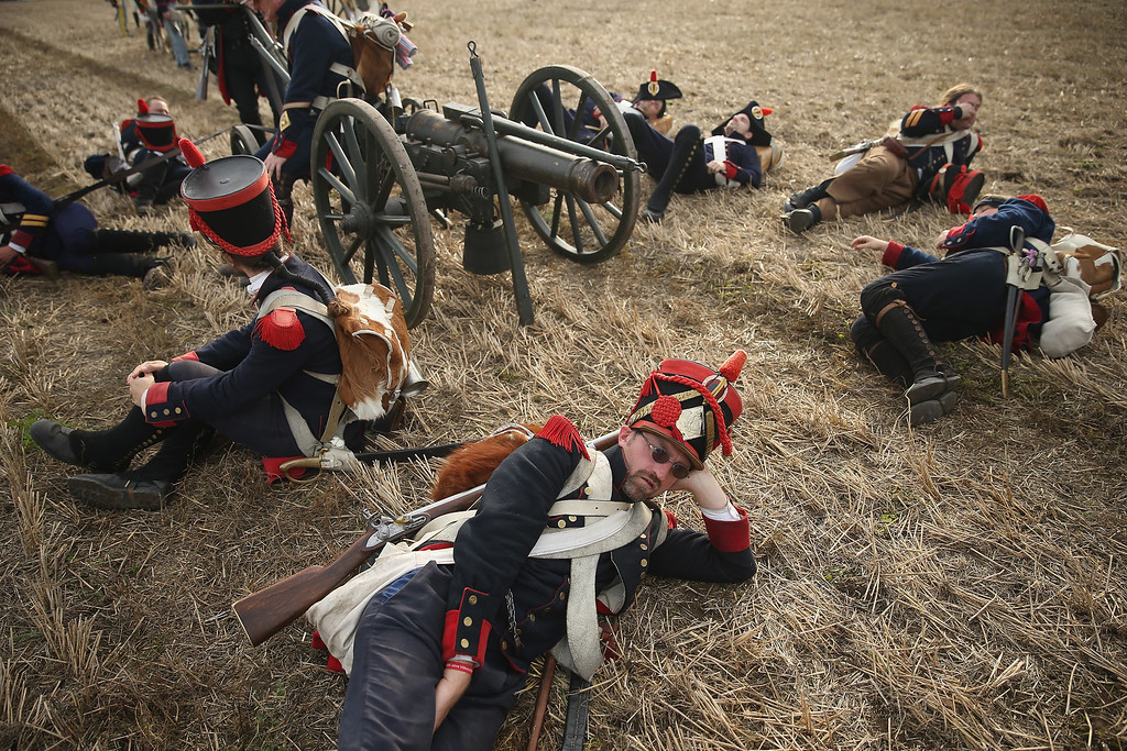 . Historical society enthusiasts from the Czech Republic in the role of French artillery soldiers fighting under Napoleon take a break upon their arrival to re-enact The Battle of Nations on its 200th anniversary on October 20, 2013 near Leipzig, Germany. (Photo by Sean Gallup/Getty Images)