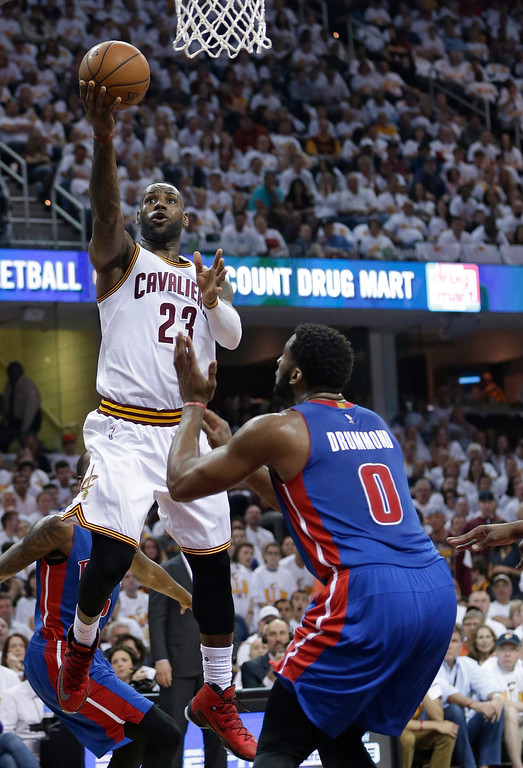 . Cleveland Cavaliers\' LeBron James (23) drives to the basket against Detroit Pistons\' Andre Drummond (0) in the first half in Game 1 of a first-round NBA basketball playoff series, Sunday, April 17, 2016, in Cleveland. The Cavaliers won 106-101. (AP Photo/Tony Dejak)