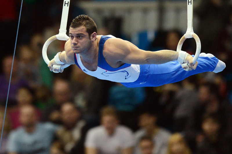. France\'s Samir Ait Said competes on the rings in the men\'s apparatus artistic gymnastics finals during the 5th European Men\'s and Women\'s Artistic Gymnastic Individual Championships in Moscow on April 20, 2013. France\'s Samir Ait Said shared the fist place with Ukraine\'s Igor Radivilov and France\'s Danny Pinheiro-Rodrigues shared the third place with Italy\'s Matteo Morandi. NATALIA KOLESNIKOVA/AFP/Getty Images