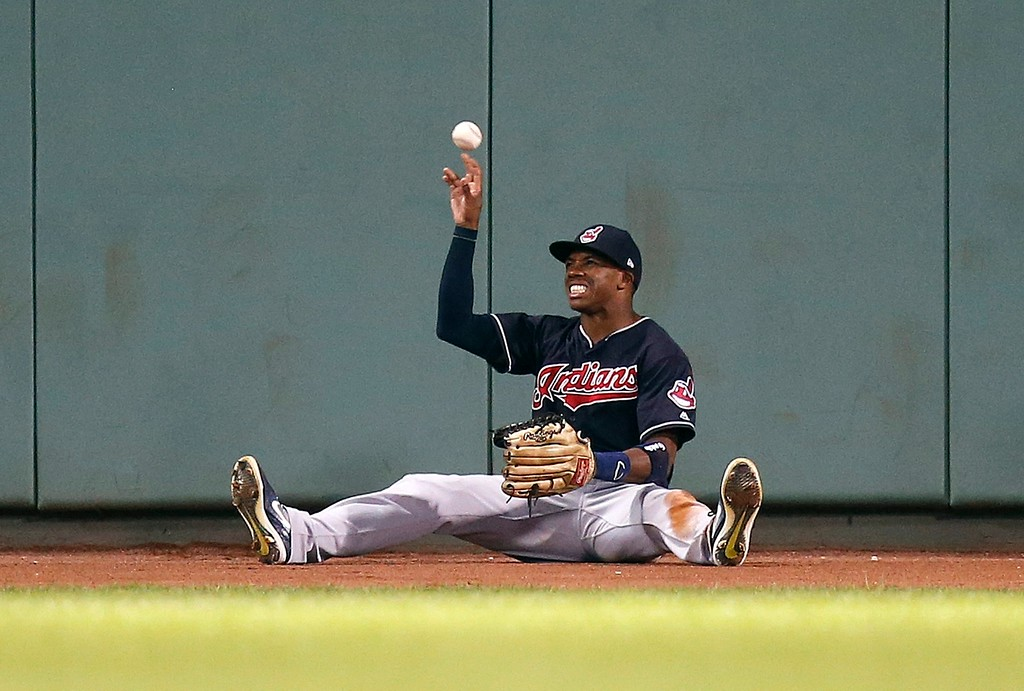 . Cleveland Indians\' Greg Allen tosses the ball after making the catch on the fly out by Boston Red Sox\'s Xander Bogaerts during the fifth inning of a baseball game in Boston, Tuesday, Aug. 21, 2018. (AP Photo/Michael Dwyer)
