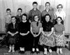 """This class photograph has been in our collection for quite some time, but it was somehow overlooked when we first assembled this <b><i>School</i></b> gallery.  How could we have overlooked such a good looking bunch!  It's the """"Upper Grades"""" from 1957-58.  Seated in front are (left-to-right):  Delores Buckley, Karen Galey, Ruth Olson, Mary Cottrell , Marie Dooley.  In the back are:  Lonnie Douthit, Tom Dooley, (unknown), Neil Daniels, and teacher, Josephine Johnson."""