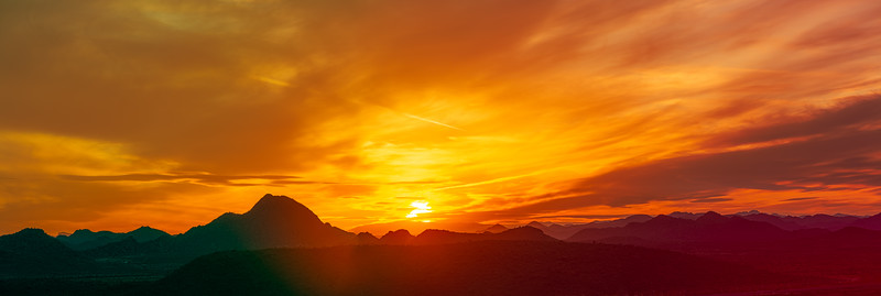 Panorama of a vivid sunset over the mountains and desert of the Sonoran Desert