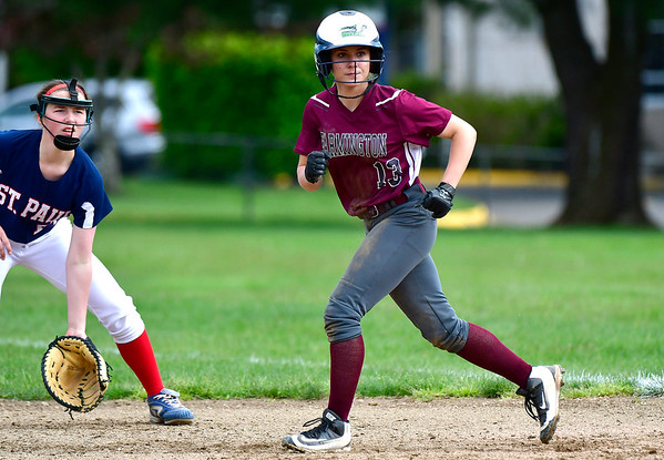 5/15/2019 Mike Orazzi | Staff Farmington's Carolyn Piera (13) during softball with St. Paul in Bristol Wednesday.