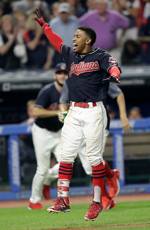 . Cleveland Indians\' Francisco Lindor celebrates after hitting a three-run home run in the ninth inning of a baseball game against the Minnesota Twins, Wednesday, Aug. 8, 2018, in Cleveland. The Indians won 5-2. (AP Photo/Tony Dejak)