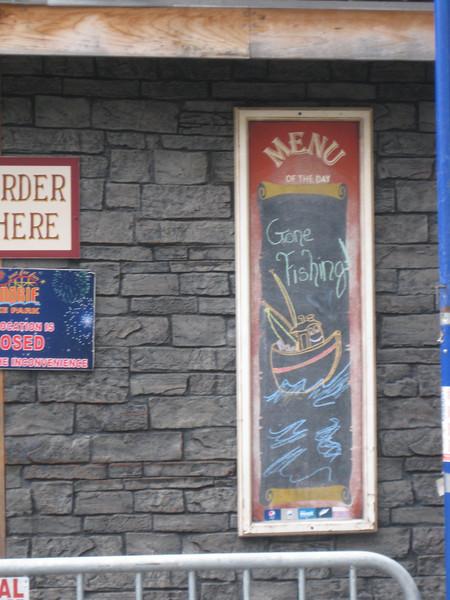 "Minuteman Fried Clams menu board says, ""Gone Fishing""."