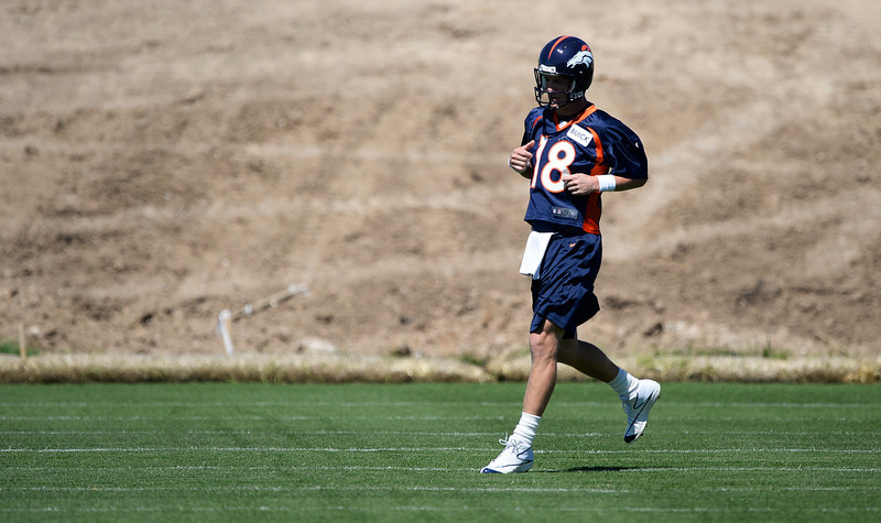 . Denver Broncos Peyton Manning (18) during practice May 28, 2014 at Dove Valley. (Photo by John Leyba/The Denver Post)