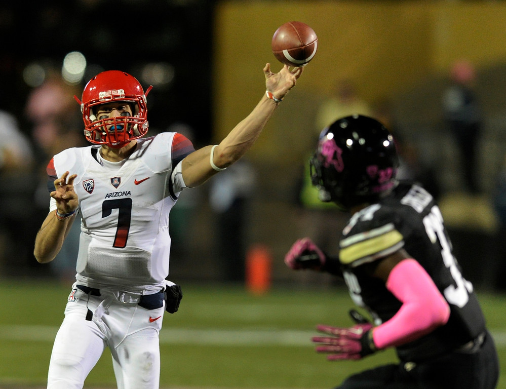 . BOULDER, CO. - OCTOBER 26: Arizona quarterback B.J. Denvker looked downfield with a pass in the first half. The University of Colorado football team hosted Arizona Saturday night, October 26, 2013. Photo By Karl Gehring/The Denver Post