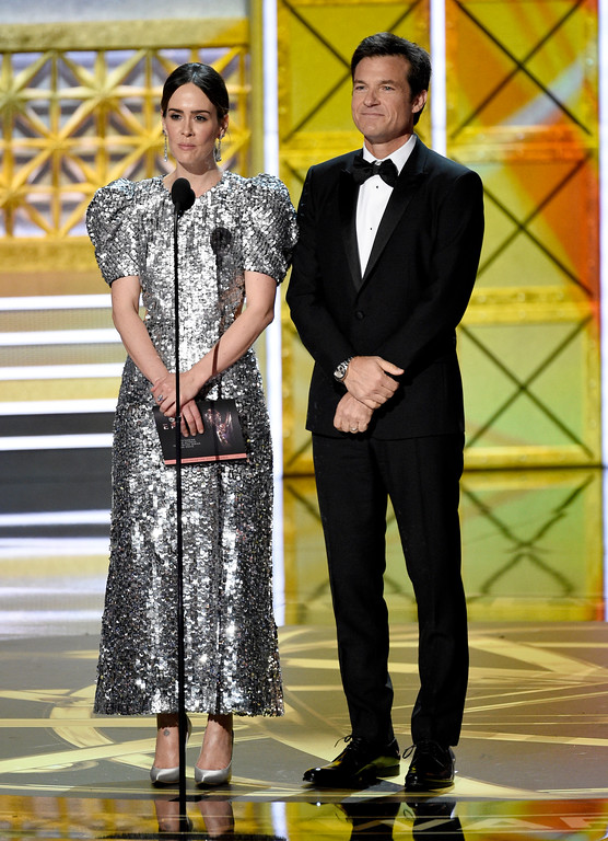 . Sarah Paulson, left, and Jason Bateman present the award for outstanding lead actress in a limited series or a movie at the 69th Primetime Emmy Awards on Sunday, Sept. 17, 2017, at the Microsoft Theater in Los Angeles. (Photo by Chris Pizzello/Invision/AP)