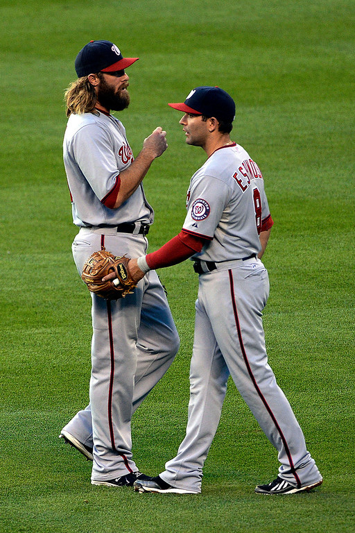 . Jayson Werth (28) of the Washington Nationals talks to Danny Espinosa (8) of the Washington Nationals after he dropped a ball hit by D.J. LeMahieu (9) of the Colorado Rockies at Coors Field. Major League Baseball action between the Colorado Rockies and the Washington Nationals on Monday, July 21, 2014. (Photo by AAron Ontiveroz/The Denver Post)