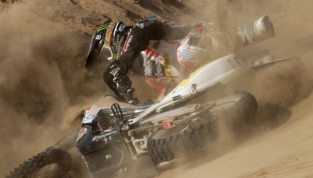 . Husqvarna rider Alessandro Botturi of Italy, falls from his motorcycle during the 3nd stage of the 2013 Dakar Rally from Pisco to Nazca, Peru, Monday, Jan. 7, 2013. The race finishes in Santiago, Chile, on Jan. 20. (AP Photo/Victor R. Caivano)