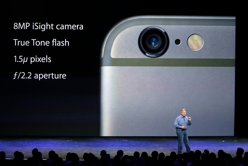 . Phil Schiller, Apple\'s senior vice president of worldwide product marketing, discusses the camera features on the new iPhone 6 and iPhone 6 plus on Tuesday, Sept. 9, 2014, in Cupertino, Calif. (AP Photo/Marcio Jose Sanchez)