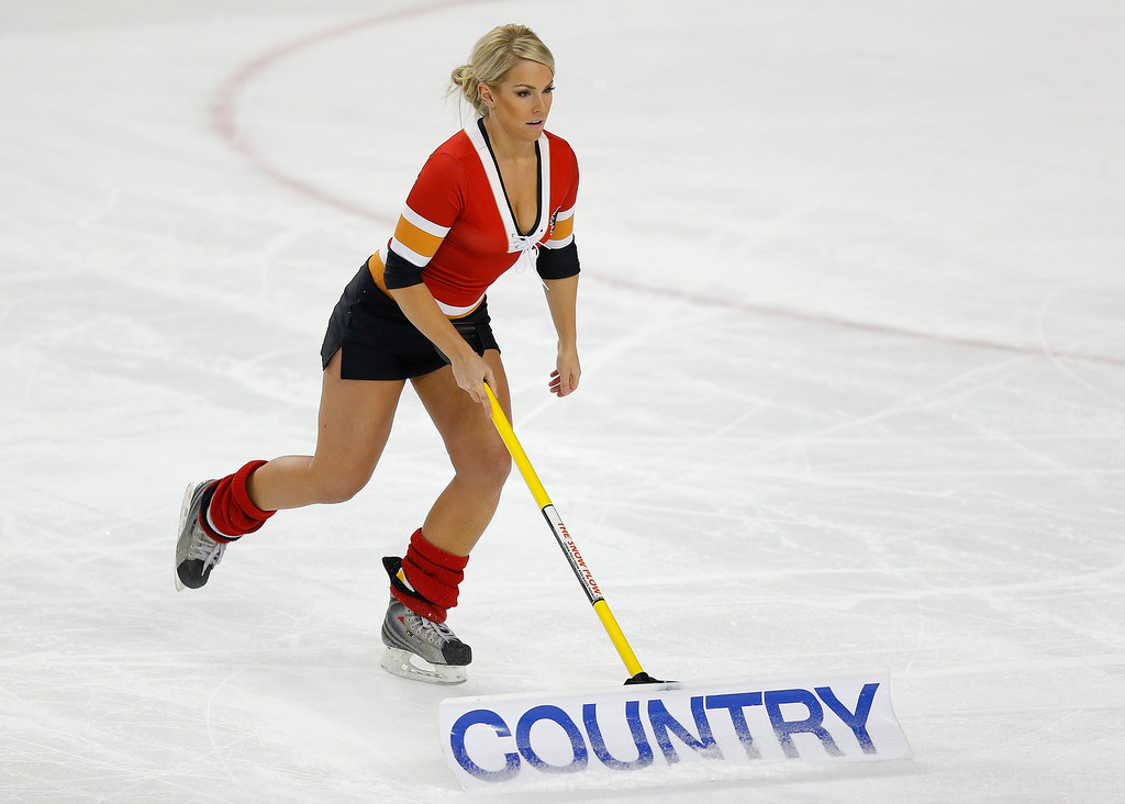 . A member of the Calgary Flames\' ice crew cleans the ice during a break in the first period of their NHL hockey game against the Colorado Avalanche in Calgary, Alberta, January 31, 2013. REUTERS/Todd Korol