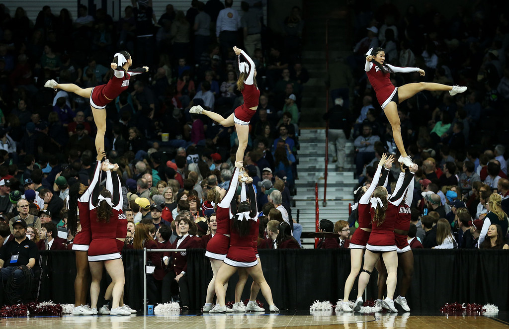 . Harvard Crimson cheerleaders perform in the first half against the Michigan State Spartans during the Third Round of the 2014 NCAA Basketball Tournament at Spokane Veterans Memorial Arena on March 22, 2014 in Spokane, Washington.  (Photo by Stephen Dunn/Getty Images)