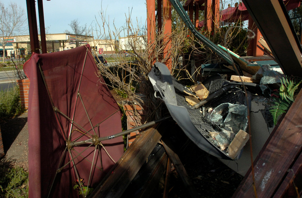. Scattered tables and other patio furniture are left toppled by a Cadillac Escalade SUV driven by accident through the Strings Italian Cafe during the lunch hour in Livermore, Calif., on Monday, Jan. 7, 2013. One customer was taken to a hospital for treatment of injuries and several other people sustained minor injuries. (Cindi Christie/Staff)