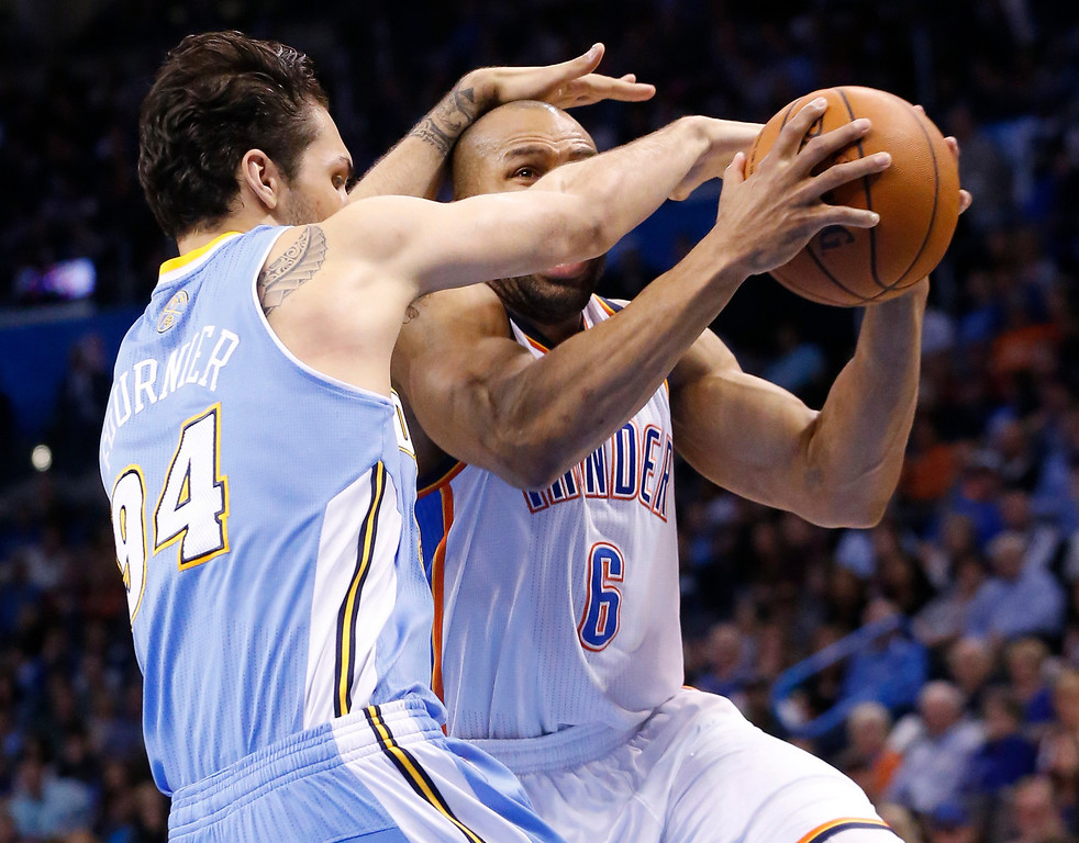 . Oklahoma City Thunder guard Derek Fisher (6) is fouled by Denver Nuggets guard Evan Fournier (94) in the fourth quarter of an NBA basketball game in Oklahoma City, Monday, March 24, 2014. Oklahoma City won 117-96.(AP Photo/Sue Ogrocki)