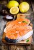 Two fresh raw salmon steaks with lemons closeup