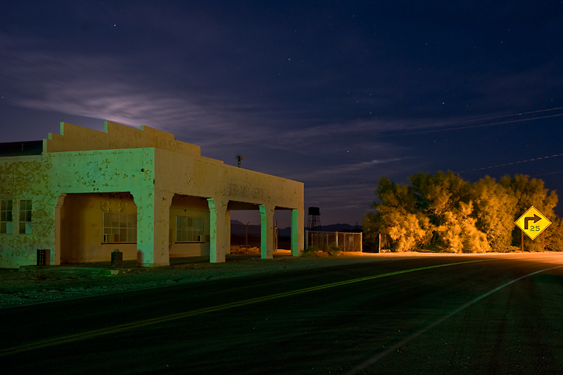 Last Chance Gas Station  Shuttered service station in Death Valley Junction.  Lit by moonlight and ambient light.  The green from flood lights from the Amargosa Opera House and the orange from a street light.