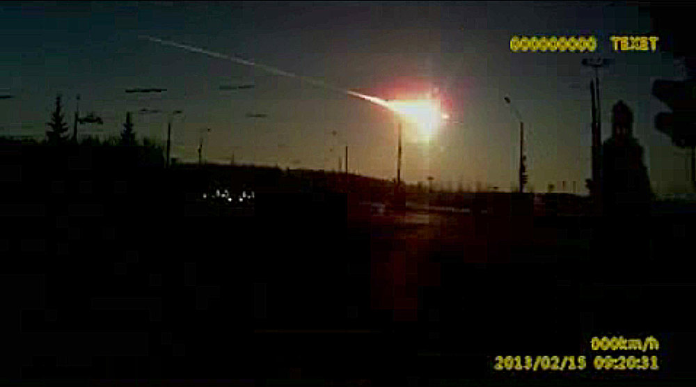 . In this frame grab made from dashboard camera video, a meteor streaks through the sky over Chelyabinsk, about 1500 kilometers (930 miles) east of Moscow, Friday, Feb. 15, 2013. With a blinding flash and a booming shock wave, the meteor blazed across the western Siberian sky Friday and exploded with the force of 20 atomic bombs, injuring more than 1,000 people as it blasted out windows and spread panic in a city of 1 million. (AP Photo/AP Video)