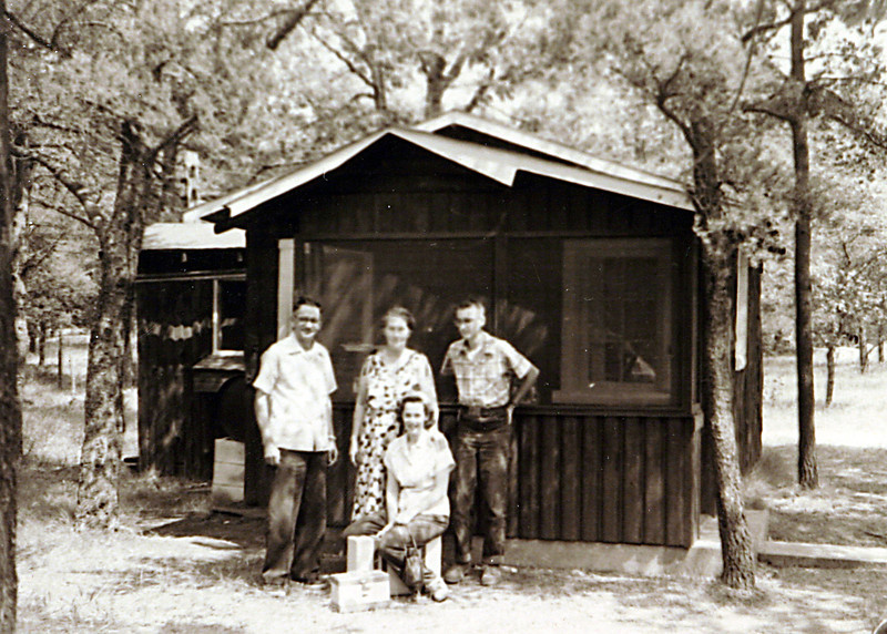 Grandpa & Grandma Laura at cabin.JPG