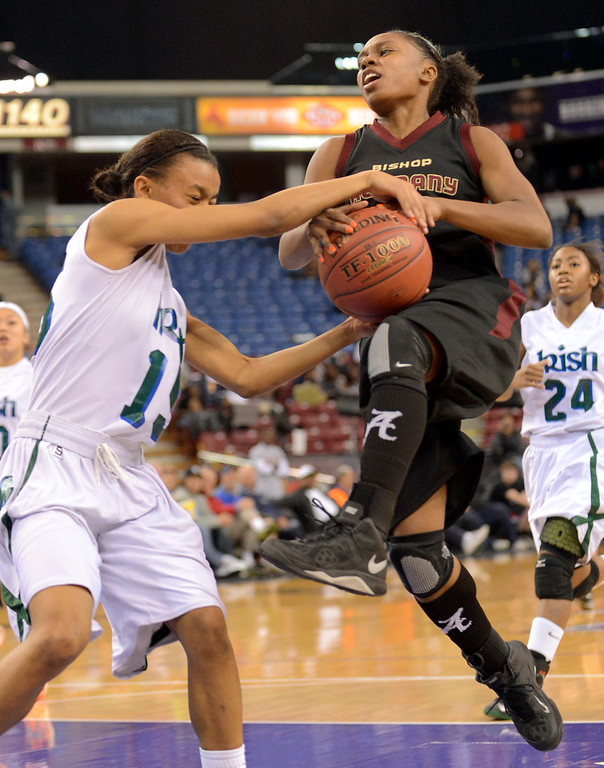. Alemany\'s Alayah Byers tries to get by Ge\'anna Summers-luaulu of Sacred Heart Cathedral during the Div III 2013 CIF State Basketball Championship game at the Sleep Train Arena, in Sacramento, Ca March 22, 2013.  Alemany won the game 46-40.(Andy Holzman/Los Angeles Daily News)