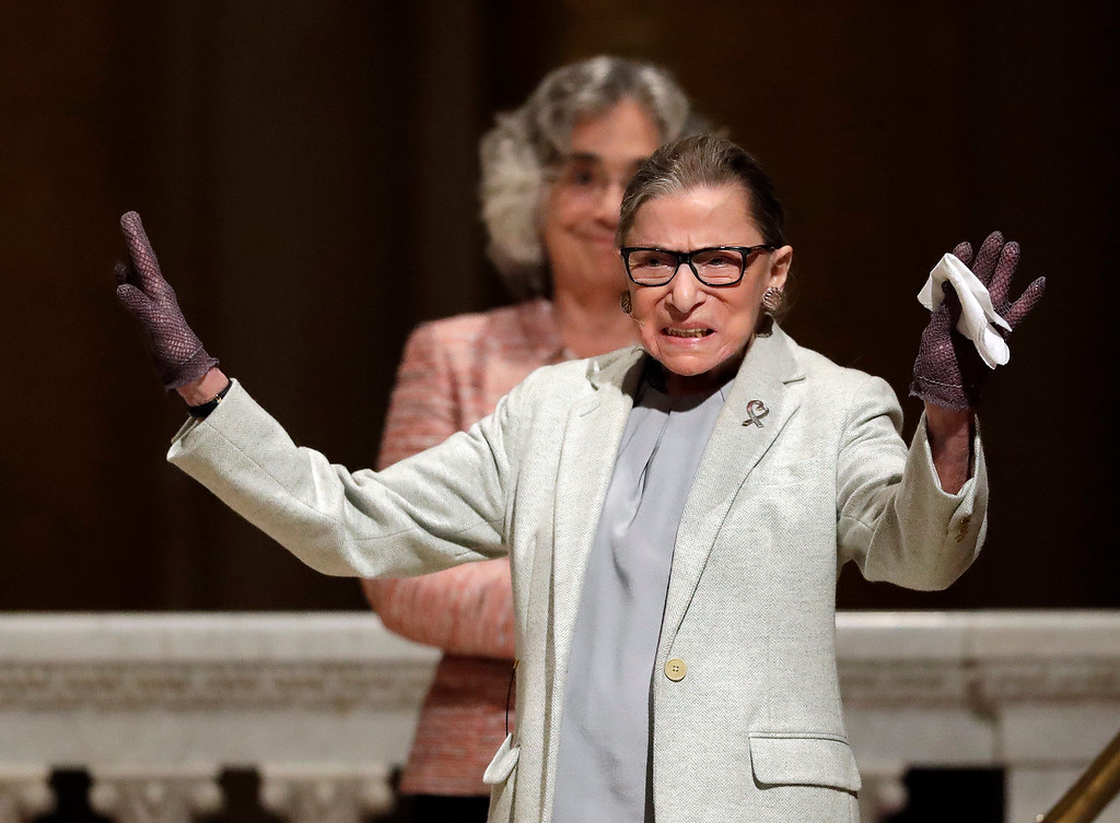 . U.S. Supreme Court Justice Ruth Bader Ginsburg waves as she is introduced during a visit to Stanford University, Monday, Feb. 6, 2017, in Stanford, Calif. (AP Photo/Marcio Jose Sanchez)