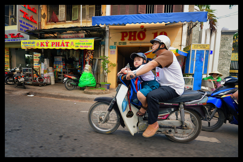 Vinh Long Vietnam, Frank McKenna, Man and boy riding scooter.