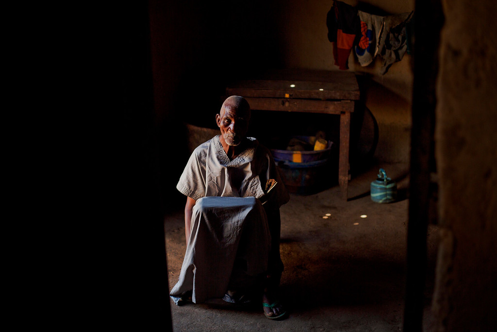 . In this photo taken Thursday Nov. 20, 2014, Kissi Dembadouno sits in his home in the Guinean village of Meliandou, some 400 miles (600 kms) south-east of Conakry, Guinea. Demnadouno lost his wife, daughter and two grandchildren to the deadly disease. He is Etienne Ouamouno\'s father in law. Etienne Ouamouno\'s 2-year old son Emile is widely recognized by researchers as Patient Zero, the first person to have died of Ebola back on December 28 last year. (AP Photo/Jerome Delay)
