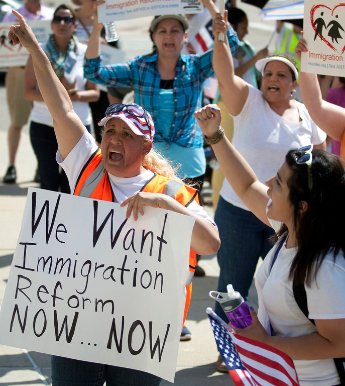 . Martina Cano joins others in a May Day march for immigration reform from the Children\'s Museum to Calder Plaza in Grand Rapids, Mich. on Wednesday, May 1, 2013. (AP Photo/MLive.com, Latara Appleby)