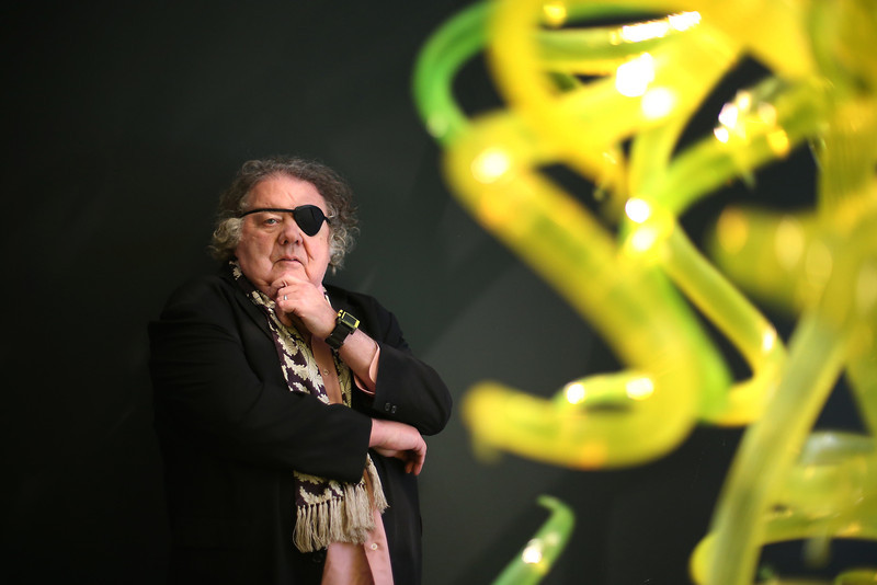 . Dale Chihuly poses with his glass sculpture \'Citron Chandelier\' at Halcyon Gallery on February 4, 2014 in London, England. American artist Dale Chihuly has transformed Halcyon Gallery with his distinctive hand-blown glass sculptures. The exhibition at 144 New Bond Street runs from February 8, 2014 - April 5, 2014. (Photo by Peter Macdiarmid/Getty Images for Halcyon Gallery)