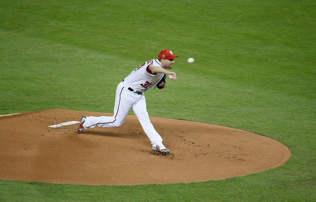 . National League\'s Washington Nationals pitcher Max Scherzer (31), throws during the first inning at the MLB baseball All-Star Game, Tuesday, July 11, 2017, in Miami. (AP Photo/Wilfredo Lee)