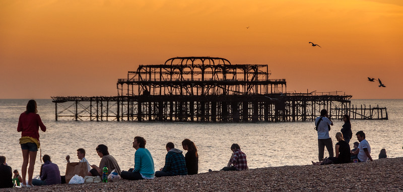 Red sky sunset at Brighton beach and West Pier