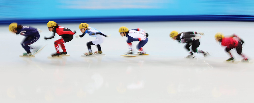 . Shim Suk Hee of Korea leads competitors on her way winning in the Heat 1 in women\'s 500m at Short Track events in the Iceberg Skating Palace at the Sochi 2014 Olympic Games, Sochi, Russia, 15 February 2014.  EPA/HANNIBAL HANSCHKE
