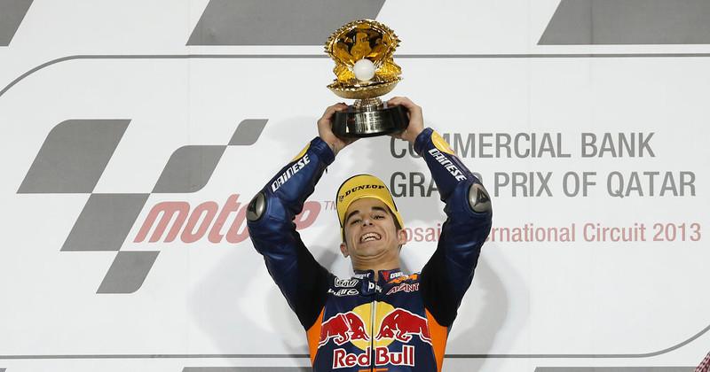 . Red Bull KTM Ajo Moto3 rider Luis Salom of Spain celebrates on the podium after winning the Qatar MotoGP Grand Prix at the Losail International circuit in Doha April 7, 2013. REUTERS/Fadi Al-Assaad