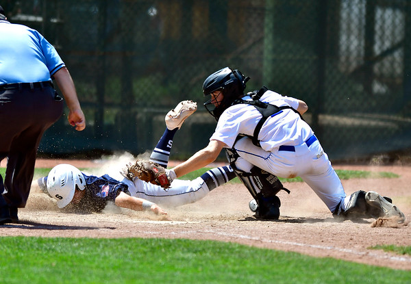 6/8/2019 Mike Orazzi | Staff Staples High School's Andrew Moy (15) tagged out at home by Southington's Jacob DelMonte (2) in the Class LL State Baseball Tournament at Palmer Field In Middletown on Saturday.