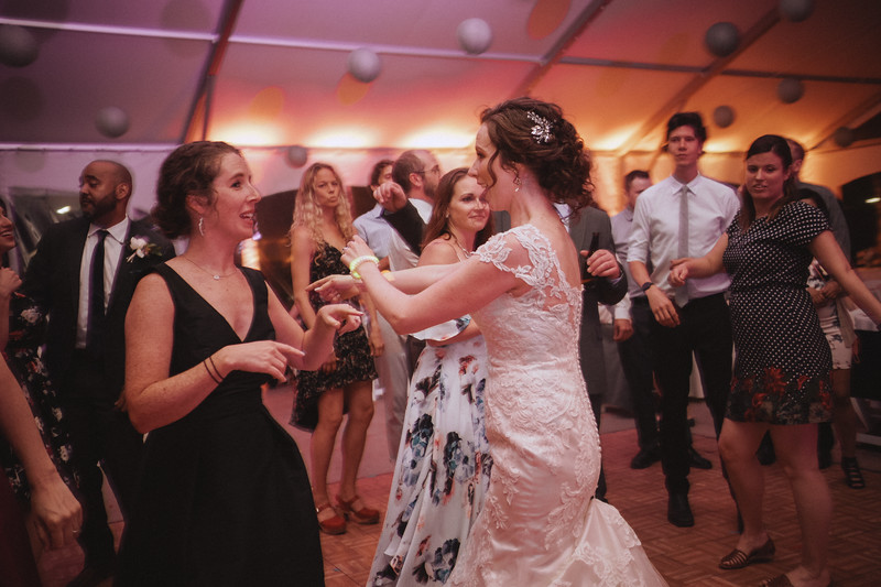 The bride dances with her sister.