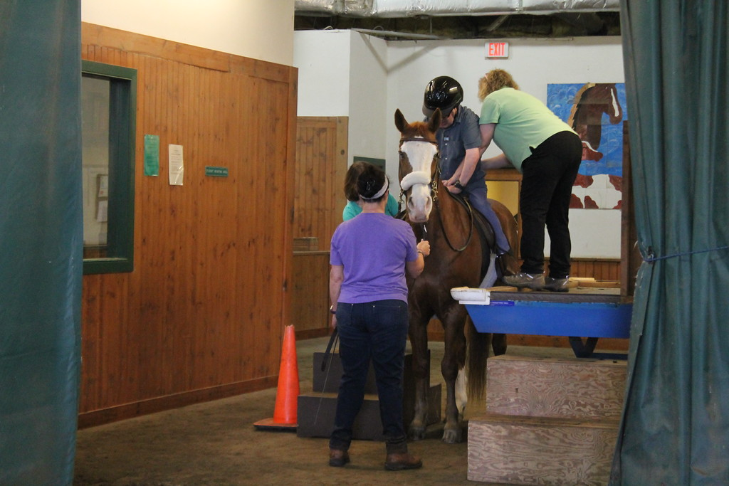 . Dan Matthes,   a client  Willoughby Branch with the help of Fieldstone Farm volunteers mounts a horse to ride as part of the equine therapy sessions clients of  Lake County\'s Board of Developmental Disabilities/Deepwood regularly participate in . Kristi Garabrandt - The News-Herald