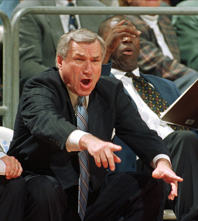 ". FILE - In a Jan. 22, 1997 file photo, North Carolina head coach Dean Smith yells at his players during ACC basketball action against Florida State in Tallahassee, Fla. Smith, the North Carolina basketball coaching great who won two national championships, died ""peacefully\"" at his home Saturday night, Feb. 7, 2015, the school said in a statement Sunday from Smith\'s family. He was 83.  (AP Photo/Phil Coale, File)"